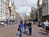 Tourists Walking in a Street  Amsterdam  Netherlands
