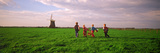 Four Children with Baskets Crossing Farmlands  Netherlands