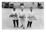 Three Chefs Stand on Steps and Hold Up Thanksgiving Platters of Pies  Apples and Turkey