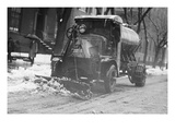 Tank Truck with Snow Plow Cleans the Streets