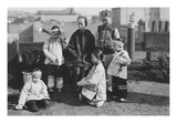 Chinese Mother with Her Children in Native Costume Sit on Rooftop