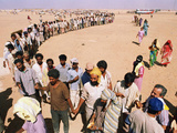 Kuwait Refugees Wait for Bread 1990