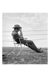 James Dean Seated Behind Fence