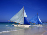 Boracay beach with traditional sailboats