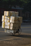 Cyclist in China with huge load of boxes