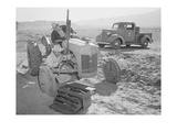 Tractor Repair: Driver Benji Iguchi  Mechanic Henry Hanawa 