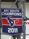 Houston Texans: Toro Hangs Next to the 2011 Banner