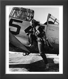 Female Pilot of the Us Women's Air Force Service Posed with Her Leg Up on the Wing of an Airplane