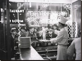 A cook preparing spaghetti  Broadway  New York City  1937