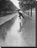 Man crossing puddle on chairs  1934
