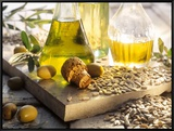 Various Oils in Carafes  Olives  Sunflower Seeds