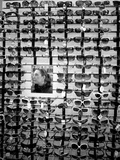 Wall of Sunglasses and Woman Reflection