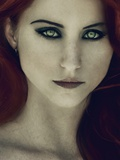 A Girl with Red Hair and Piercing Eyes