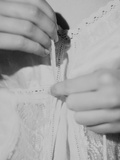 A Young Womans Hands Holding a Piece of Lace