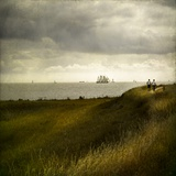 Man and Woman Walking Along a Path by the Sea with Tall Ships