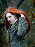 A Girl with Red Hair in the Forest