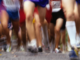Blurred Action of Runner's Legs Competing in a Race