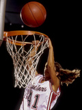 Female Basketball Player Slam Dunking