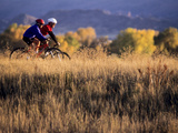 Couple Mountain Biking in Fall
