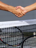 Tennis Players Handshake over the Net