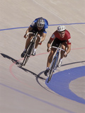 Cyclist Competing on the Velodrome Track