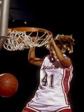 Female Basketball Player Slam Dunking