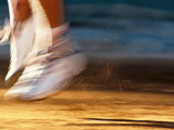 Detail of Blurred Action of Tennis Players Feet During a Serve