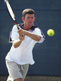Young Male Tennis Player in Action