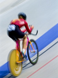 Blurred Action of Cyclist Racing on the Velodrome