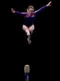 Female Gymnast Performing on the Balance Beam