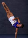 Male Gymnast Performing on the Floor Exercise