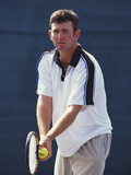 Young Male Tennis Player Serving