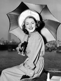 Eleanor Parker Sports a New English Umbrella as She Arrives in NY on the Queen Elizabeth  June 1948