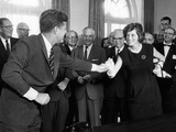 Eunice Shriver Receives a Signing Pen from Her Brother  President John Kennedy