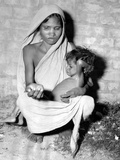 Mother of a Starving Child Begs for Help in Calcutta in October 1943