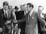 George Wallace Stepping Aside as Pres John Kennedy Walks to Platform at Muscle Shoals  Alabama