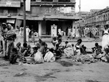 At the Peak of India's Famine in Late Oct 1943  Starving Homeless People Huddle in Calcutta Street
