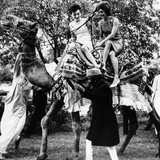 Jacqueline Kennedy and Her Sister  Princess Lee Radziwill Riding a Camel