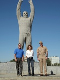 Us Astronauts and Russian Cosmonauts Pose in Front of a Monumental Statue of Yuri Gagarin
