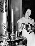 Lady Bird Johnson Holds a Silver Teapot Made by Issac Hutton
