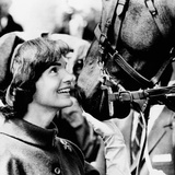 Jacqueline Kennedy Beams at One of the Famed Horses of the Canadian Royal Mounted Police