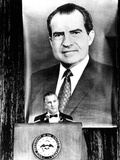 A Huge Portrait of President Nixon Dominates the Scene