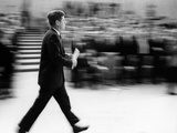 Pres John Kennedy Walking Fast after Press Conference in State Department Auditorium  Mar 11  1963