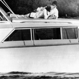 Lynda Bird Johnson Relaxes on Her Father&#39;s Cabin Cruiser with Weekend Guest  Actor George Hamilton