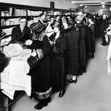 Women Eagerly Shop across the Counter at a Newly Opened Sears Retail Store