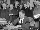 Pres Franklin Roosevelt Signs Joint Congressional Resolution Declaring War  4:10pm  Dec 8  1941