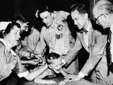 Several Doctors and Nurses Restrain Young Ernest Booth