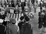 Jacqueline Kennedy Stands Forward as the Flag from Her Husband's Coffin Is Raised for Folding