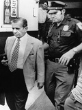 Meyer Lansky Leaves the Federal Courthouse in Miami Escorted by Government Security Guards