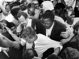 Sen Robert Kennedy Tugged at from Every Direction